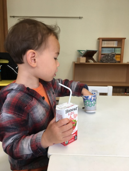 Snack time = his favorite part of the preschool day