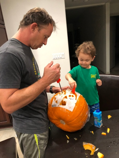 Jacob helping carve a pumpkin. My 2nd pumpkin ever!